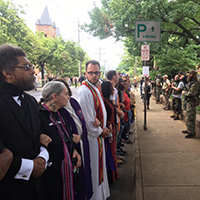 Clergy peacefully lined up facing White Supremacists carrying rifles in Charlottesville, VA August 12